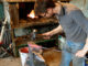Blacksmith forging red-hot metal with hammer. \